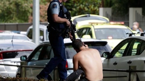 <p>               A man rests on the ground as he speaks on his mobile phone across the road from mosque in central Christchurch, New Zealand, Friday, March 15, 2019. A witness says a number of people have been killed in a mass shooting at a mosque in the New Zealand city of Christchurch; police urge people to stay indoors. (AP Photo/Mark Baker)             </p>