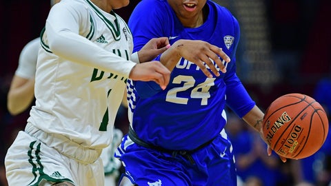 <p>               Buffalo guard Cierra Dillard drives on Ohio guard Cece Hooks during the first half of an NCAA college basketball championship game of the Mid-American Conference women's tournament, Saturday, March 16, 2019, in Cleveland. (AP Photo/David Dermer)             </p>