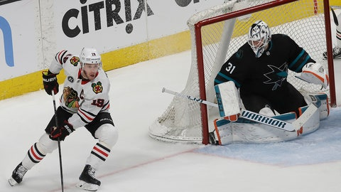 <p>               Chicago Blackhawks center Jonathan Toews (19) skates next to San Jose Sharks goaltender Martin Jones (31) during the third period of an NHL hockey game in San Jose, Calif., Thursday, March 28, 2019. (AP Photo/Jeff Chiu)             </p>