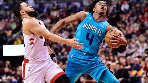 <p>               Charlotte Hornets guard Devonte' Graham (4) drives past Toronto Raptors guard Fred VanVleet (23) during the second half of an NBA basketball game Sunday, March 24, 2019, in Toronto. (Frank Gunn/The Canadian Press via AP)             </p>