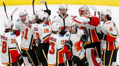 <p>               Calgary Flames goaltender Mike Smith (41) celebrates 5-3 win against the San Jose Sharks with teammates in the third period of an NHL hockey game in San Jose, Calif., Sunday, March 31, 2019. (AP Photo/Josie Lepe)             </p>