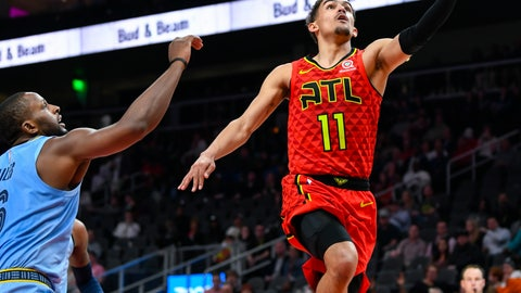 <p>               Atlanta Hawks guard Trae Young (11) lays up past the defense of Memphis Grizzlies forward CJ Miles during the second quarter of an NBA basketball game, Wednesday, March 13, 2019, in Atlanta. (AP Photo/John Amis)             </p>