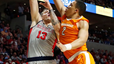 <p>               Tennessee forward Grant Williams (2) blocks a shot attempt by Mississippi center Dominik Olejniczak (13) during the second half of an NCAA college basketball game in Oxford, Miss., Wednesday, Feb. 27, 2019. Tennessee won 73-71. (AP Photo/Rogelio V. Solis)             </p>