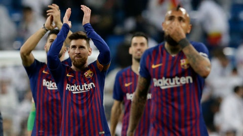 <p>               Barcelona forward Lionel Messi, left, applauds fans at the end of the Copa del Rey semifinal second leg soccer match between Real Madrid and FC Barcelona at the Bernabeu stadium in Madrid, Spain, Wednesday Feb. 27, 2019. (AP Photo/Andrea Comas)             </p>