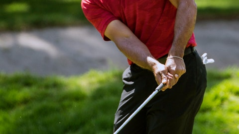 <p>               FILE - In this Feb. 24, 2019, file photo, Tiger Woods hits the ball on the first hole during the WGC-Mexico Championship at the Chapultepec Golf Club in Mexico City. Woods has withdrawn from the Arnold Palmer Invitational with what he describes as a neck strain. Woods announced his decision Monday. March 4, 2019, on Twitter. (AP Photo/Christian Palma, File)             </p>