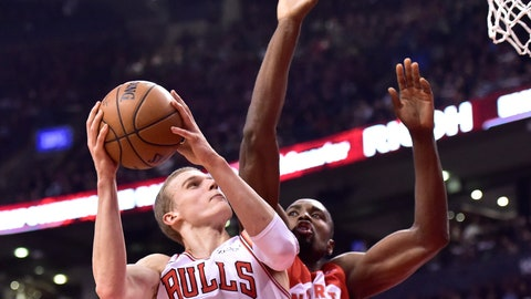 <p>               Chicago Bulls forward Lauri Markkanen (24) heads for the basket as Toronto Raptors center Serge Ibaka (9) defends during the first half of an NBA basketball game in Toronto on Tuesday, March 26, 2019. (Frank Gunn/The Canadian Press via AP)             </p>