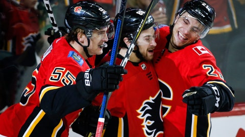 <p>               Calgary Flames' Andrew Mangiapane, centre, celebrates his goal with teammates Noah Hanifin, left, and Garnet Hathaway during first period NHL hockey action against the Vegas Golden Knights in Calgary, Alberta, Sunday, March 10, 2019. (Jeff McIntosh/The Canadian Press via AP)             </p>