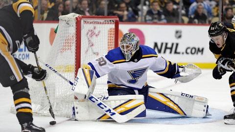 <p>               St. Louis Blues goaltender Jordan Binnington (50) blocks a shot by Pittsburgh Penguins' Evgeni Malkin, left, during the second period of an NHL hockey game in Pittsburgh, Saturday, March 16, 2019. (AP Photo/Gene J. Puskar)             </p>