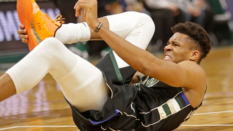 <p>               Milwaukee Bucks' Giannis Antetokounmpo grabs his foot during the first half of an NBA basketball game against the Miami Heat, Friday, March 22, 2019, in Milwaukee. (AP Photo/Jeffrey Phelps)             </p>