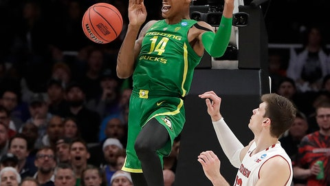 <p>               Oregon forward Kenny Wooten (14) reacts after dunking over Wisconsin forward Ethan Happ during the second half of a first-round game in the NCAA men's college basketball tournament, Friday, March 22, 2019, in San Jose, Calif. (AP Photo/Chris Carlson)             </p>