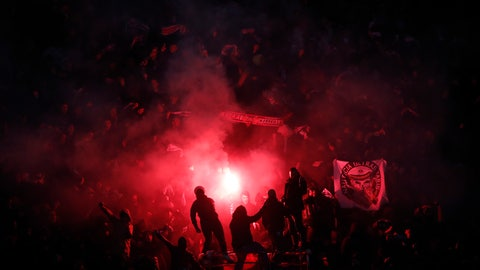 <p>               PSG supporters set off flares after their team scored 1-0 during the French League One soccer match between Paris-Saint-Germain and Olympique Marseille at the Parc des Princes stadium in Paris, Sunday, March 17, 2019. (AP Photo/Christophe Ena)             </p>