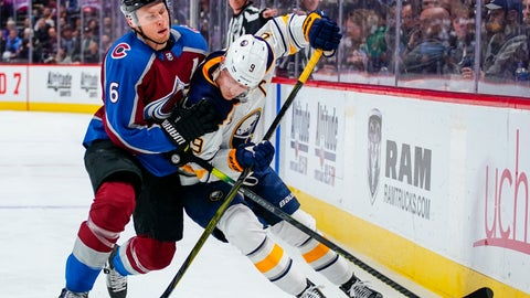 <p>               Colorado Avalanche defenseman Erik Johnson (6) hits Buffalo Sabres center Jack Eichel (9) during the second period of an NHL hockey game Saturday, March 9, 2019, in Denver. (AP Photo/Jack Dempsey)             </p>