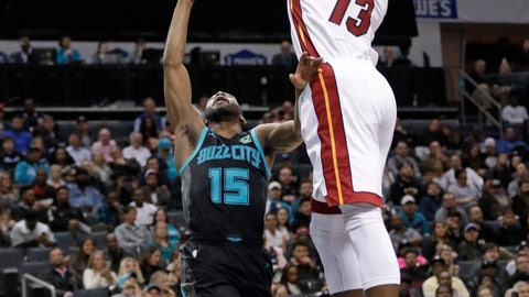 <p>               Charlotte Hornets' Kemba Walker (15) tries to shoot over Miami Heat's Bam Adebayo (13) during the first half of an NBA basketball game in Charlotte, N.C., Wednesday, March 6, 2019. (AP Photo/Chuck Burton)             </p>