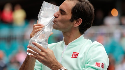<p>               Roger Federer, of Switzerland, kisses the trophy after defeating John Isner during the singles final of the Miami Open tennis tournament, Sunday, March 31, 2019, in Miami Gardens, Fla. (AP Photo/Lynne Sladky)             </p>