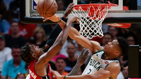 <p>               Milwaukee Bucks forward Giannis Antetokounmpo, right, blocks a shot by Miami Heat guard Josh Richardson during the second half of an NBA basketball game Friday, March 15, 2019, in Miami. The Bucks defeated the Heat 113-98. (AP Photo/Wilfredo Lee)             </p>