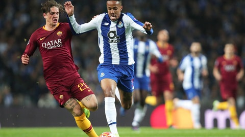 <p>               Roma midfielder Nicolo' Zaniolo, left, vies for the ball with Porto defender Eder Militao during the Champions League round of 16, 2nd leg, soccer match between FC Porto and AS Roma at the Dragao stadium in Porto, Portugal, Wednesday, March 6, 2019. (AP Photo/Luis Vieira)             </p>