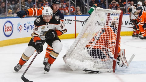 <p>               Anaheim Ducks' Jakob Silfverberg (33) is chased by Edmonton Oilers' Colby Cave (12) as the net gets knocked over goalie Mikko Koskinen (19) during the first period of an NHL hockey game Saturday, Feb. 23, 2019, in Edmonton, Alberta. (Jason Franson/The Canadian Press via AP)             </p>