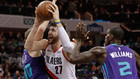 <p>               Portland Trail Blazers' Jusuf Nurkic (27) drives between Charlotte Hornets' Marvin Williams (2) and Cody Zeller (40) during the first half of an NBA basketball game in Charlotte, N.C., Sunday, March 3, 2019. (AP Photo/Chuck Burton)             </p>