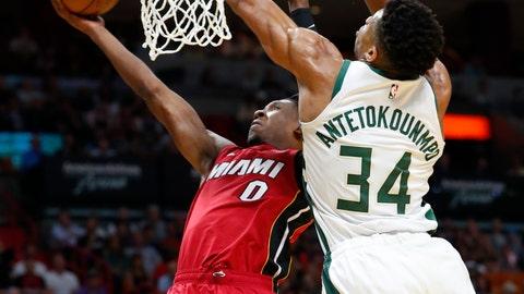 <p>               Miami Heat guard Josh Richardson (0) shoots next to Milwaukee Bucks forward Giannis Antetokounmpo (34) during the first half of an NBA basketball game Friday, March 15, 2019, in Miami. (AP Photo/Wilfredo Lee)             </p>
