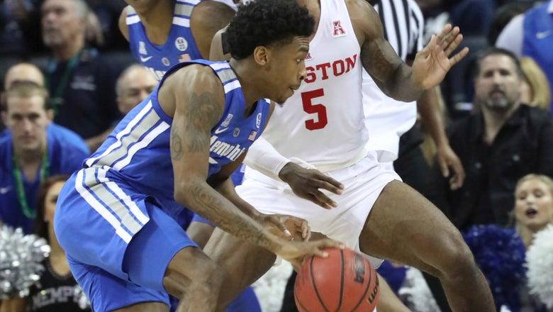 Davis, defense help No. 11 Houston hold off Memphis 61-58