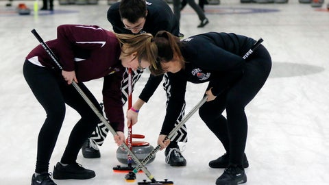<p>               Colgate team members sweep ahead of a rock during the college curling national championship, Friday, March 8, 2019, in Wayland, Mass. (AP Photo/Bill Sikes)             </p>
