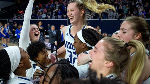 <p>               Rice center Nancy Mulkey (32) celebrates with her teammates after defeating Middle Tennessee 69-54 in an NCAA college basketball game in the championship game of the Conference USA women's tournament, Saturday, March 16, 2019, in Frisco, Texas. (AP Photo/Jeffrey McWhorter)             </p>