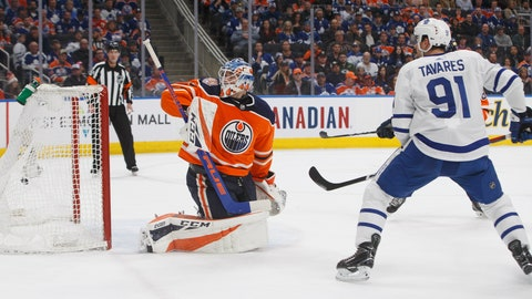 <p>               Toronto Maple Leafs' John Tavares (91) watches the puck go past Edmonton Oilers' goalie Anthony Stolarz (32) during the first period of an NHL hockey game Saturday, March 9, 2019, in Edmonton, Alberta. (Jason Franson/The Canadian Press via AP)             </p>