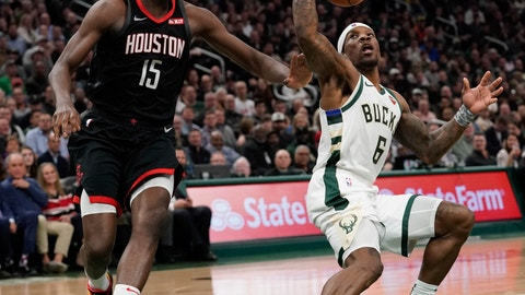 <p>               Milwaukee Bucks' Eric Bledsoe tries to fake Houston Rockets' Clint Capela during the second half of an NBA basketball game Tuesday, March 26, 2019, in Milwaukee. The Bucks won 108-94. (AP Photo/Morry Gash)             </p>