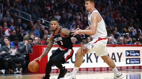 <p>               Portland Trail Blazers' Damian Lillard, left, drives against Los Angeles Clippers' Ivica Zubac during the first half of an NBA basketball game Tuesday, March 12, 2019, in Los Angeles. (AP Photo/Ringo H.W. Chiu)             </p>