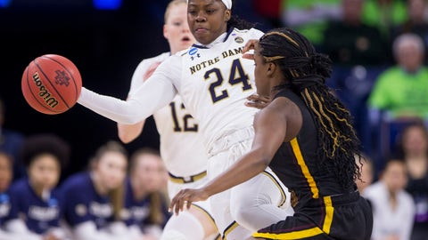 <p>               Notre Dame's Arike Ogunbowale (24) passes the ball around Bethune-Cookman's Armani Walker (5) during a first round women's college basketball game in the NCAA Tournament in South Bend, Ind., Saturday, March 23, 2019. (AP Photo/Robert Franklin)             </p>