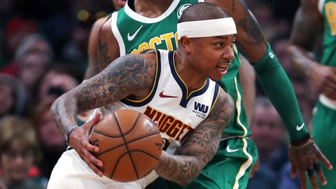 <p>               Denver Nuggets guard Isaiah Thomas drives past Boston Celtics guard Kyrie Irving, rear, during the first quarter of an NBA basketball game in Boston, Monday, March 18, 2019. Thomas returned to play in his first game after being traded in 2017 for Irving. (AP Photo/Charles Krupa)             </p>