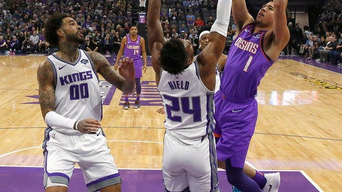 <p>               Phoenix Suns guard Devin Booker, right, goes up for the shot against Sacramento Kings guard Buddy Hield, center, as Kings center Willie Cauley-Stein, left, watches during the first quarter of an NBA basketball game Saturday, March 23, 2019, in Sacramento, Calif. (AP Photo/Rich Pedroncelli)             </p>