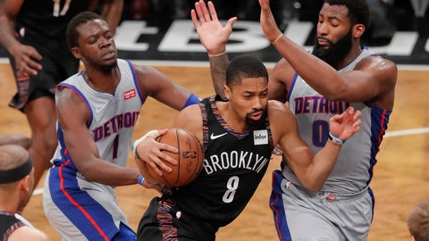 <p>               Brooklyn Nets guard Spencer Dinwiddie (8) drives against Detroit Pistons guard Reggie Jackson (1) and Detroit Pistons center Andre Drummond (0) during the third quarter of an NBA basketball game, Monday, March 11, 2019, in New York. (AP Photo/Julie Jacobson)             </p>