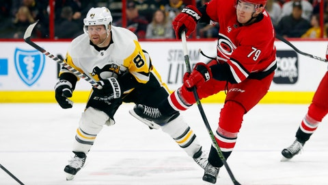 <p>               Carolina Hurricanes' Micheal Ferland (79) avoids Pittsburgh Penguins' Phil Kessel (81) to fire the puck on goal during the first period of an NHL hockey game, Tuesday, March 19, 2019, in Raleigh, N.C. (AP Photo/Karl B DeBlaker)             </p>