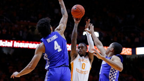 <p>               Tennessee guard Jordan Bone (0) shoots over Kentucky forward Nick Richards (4) and guard Keldon Johnson (3) during the first half of an NCAA college basketball game Saturday, March 2, 2019, in Knoxville, Tenn. (AP Photo/Wade Payne)             </p>