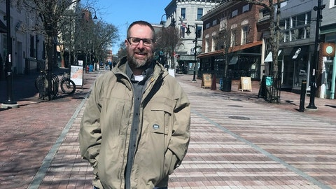 "<p>               This photo provided by Casandra Nigl shows Gregg Nigl posed in Burlington, Vt., Tuesday, March 26, 2019. By the end of the day Tuesday he was a national celebrity, the only known person among the tens of millions who filled out NCAA Tournament brackets online to have picked every game correctly through the first two rounds. That's 48-0. The NCAA, which analyzed major online bracket games, says it's close to impossible to do.  ""My phone did not stop ringing,"" said Nigl, a 40-year-old neuropsychologist who lives in Columbus but happened to be vacationing in Vermont when the news broke. (Casandra Nigl via AP)             </p>"