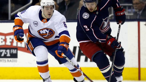 <p>               Columbus Blue Jackets forward Artemi Panarin, right, of Russia, chases the puck against New York Islanders defenseman Ryan Pulock during the first period of an NHL hockey game in Columbus, Ohio, Tuesday, March 26, 2019. (AP Photo/Paul Vernon)             </p>