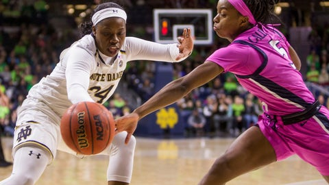 <p>               Notre Dame's Arike Ogunbowale (24) and Virginia's Khyasia Caldwell (5) compete for the ball during the first half of an NCAA college basketball game Sunday, March 3, 2019, in South Bend, Ind. (AP Photo/Robert Franklin)             </p>