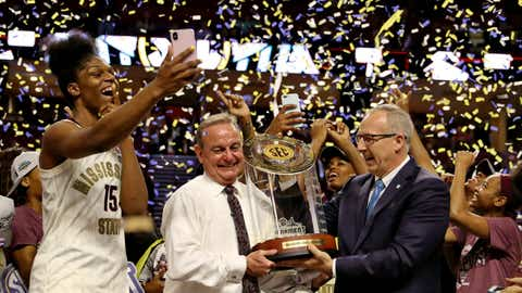 <p>               Mississippi State head coach Vic Schaefer, center, is presented the Tournament trophy by SEC commissioner Greg Sankey while MVP Teaira McCowan takes a photo after winning an NCAA college basketball championship game  against Arkansas in the Southeastern Conference women's tournament, Sunday, March 10, 2019, in Greenville, S.C. (AP Photo/Richard Shiro)             </p>