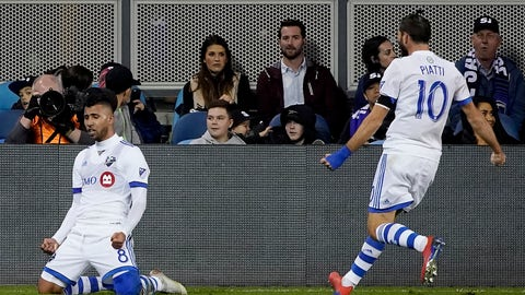 <p>               Montreal Impact midfielder Saphir Taider, left, slides on his knees as he celebrates with teammate Ignacio Piatti (10) after scoring a goal against the San Jose Earthquakes during the first half of an MLS soccer match in San Jose, Calif., Saturday, March 2, 2019. (AP Photo/Tony Avelar)             </p>