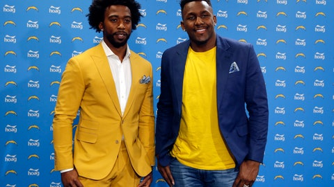 <p>               Los Angeles Chargers quarterback Tyrod Taylor, left, and linebacker Thomas Davis, right, poses for a photo during a news conference at the NFL football team's headquarters Friday, March 15, 2019, in Costa Mesa, Calif. Taylor and Davis both are signed to a two-year contract with the Chargers, the team announced Wednesday. (AP Photo/Gregory Bull)             </p>