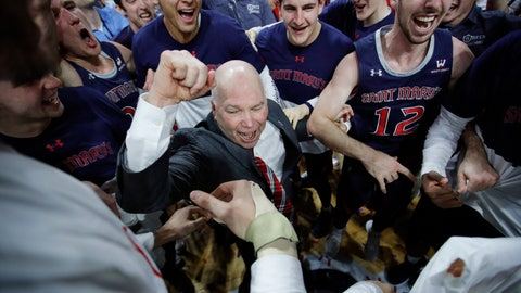 <p>               FILE - In this March 12, 2019, file photo, St. Mary's head coach Randy Bennett celebrates with his team after they defeated Gonzaga 60-47 in an NCAA college basketball game in the championship of the West Coast Conference tournament in Las Vegas. In all of his successful years at tiny Saint Mary's College and the challenge of turning around a program almost two decades ago, this NCAA Tournament berth is perhaps the most gratifying yet for Bennett. (AP Photo/John Locher, File)             </p>