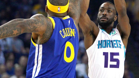 <p>               Charlotte Hornets guard Kemba Walker (15) takes a 3-point shot over Golden State Warriors center DeMarcus Cousins (0) during the first half of an NBA basketball game Sunday, March 31, 2019, in Oakland, Calif. (AP Photo/Tony Avelar)             </p>