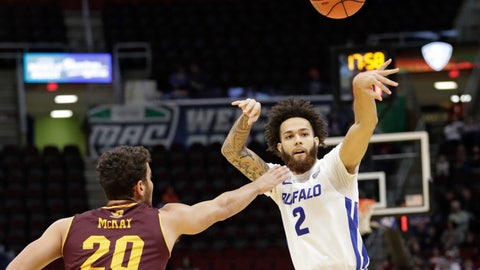 <p>               Buffalo's Jeremy Harris (2) passes against Central Michigan's Kevin McKay (20) during the first half of an NCAA college basketball game in the semifinals of the Mid-American Conference men's tournament Friday, March 15, 2019, in Cleveland. (AP Photo/Tony Dejak)             </p>