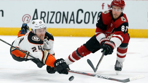 <p>               Anaheim Ducks center Carter Rowney (24) shoots in front of Arizona Coyotes defenseman Jordan Oesterle during the third period during an NHL hockey game Thursday, March 14, 2019, in Glendale, Ariz. Arizona defeated Anaheim 6-1. (AP Photo/Rick Scuteri)             </p>