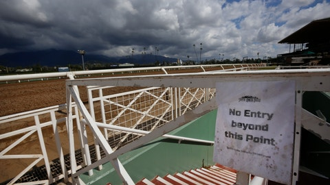 <p>               Heavy clouds are seen over the San Gabriel Mountains at Santa Anita Park in Arcadia, Calif., Thursday, March 7, 2019. Extensive testing of the dirt track is under way at eerily quiet Santa Anita, where the deaths of 21 thoroughbreds in two months has forced the indefinite cancellation of horse racing and thrown the workaday world of trainers, jockeys and horses into disarray.  (AP Photo/Damian Dovarganes)             </p>