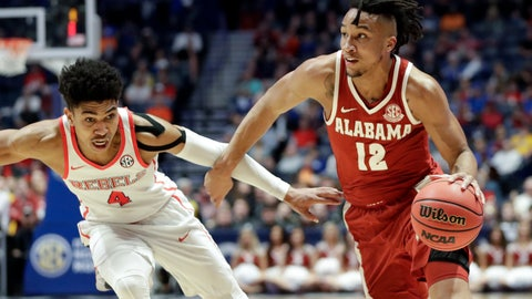 <p>               Alabama guard Dazon Ingram (12) drives against Mississippi guard Breein Tyree (4) in the first half of an NCAA college basketball game at the Southeastern Conference tournament Thursday, March 14, 2019, in Nashville, Tenn. (AP Photo/Mark Humphrey)             </p>