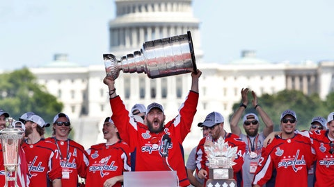 <p>               FILE - In this June 12, 2018, file photo, Washington Capitals' Alex Ovechkin, of Russia, holds up the Stanley Cup trophy during the NHL hockey team's Stanley Cup victory celebration at the National Mall in Washington. The U.S. Capitol rises in the background. A person with direct knowledge of the decision says the Capitals will go to the White House on Monday, March 25, 2019, to celebrate their Stanley Cup championship. The person spoke to The Associated Press on condition of anonymity Tuesday, March 19, 2019, because the team had not announced the decision.(AP Photo/Jacquelyn Martin, File)             </p>