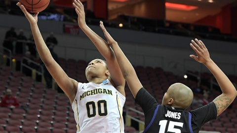 <p>               Michigan forward Naz Hillmon (00) goes in for a layup past the defense of Kansas State forward Kali Jones (15) during the second half of a first-round game in the NCAA women's college basketball tournament in Louisville, Ky., Friday, March 22, 2019. (AP Photo/Timothy D. Easley)             </p>