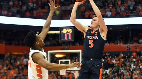 <p>               Virginia guard Kyle Guy, right, shoots over Syracuse guard Tyus Battle during the first half of an NCAA college basketball game in Syracuse, N.Y., Monday, March 4, 2019. (AP Photo/Adrian Kraus)             </p>
